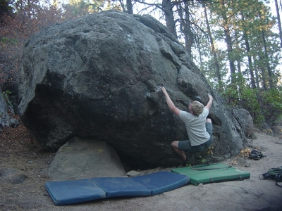 Dane Peterson stretching for his next hold - Widgi Creek Bouldering - Bend, Oregon