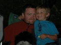 Tanis ODonnell and dad getting snuggle time at the campfire